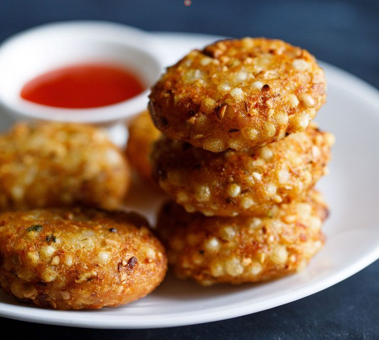 Sabudana Vada is a crispy delicious snack made by deep frying spiced sabudana, potato cutlets with Cheezy filling. Sabudana vada is a popular recipe for vrats/fasts as it contains no onion and garlic. Sabudana (also known as sago or tapioca) is one of the most common ingredients used for making recipes for vrats during festivals like Navratras. These vadas can be made as a snack or an appetizer.